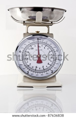Kitchen Scales on white background with reflection - stock photo