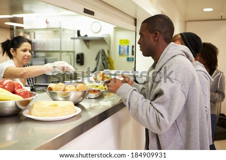 Kitchen Serving Food In Homeless Shelter - stock photo
