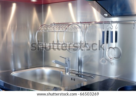 Kitchen silver sink and vitroceramic stove hob modern decoration