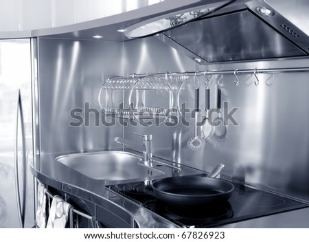 Kitchen silver sink and vitroceramic stove hob modern decoration - stock photo