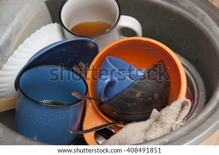 kitchen sink and dirty dishes - stock photo