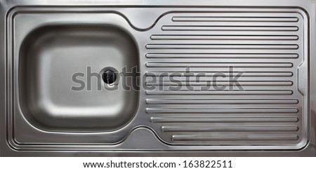 Kitchen sink made from  polished steel as commonly used in private household. - stock photo