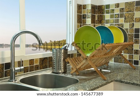 kitchen sink with wooden plate rack in asian kitchen style - stock photo