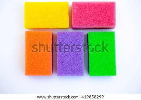 Kitchen sponges for washing dishes isolated on white background - stock photo