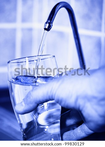 kitchen still life. home filter crane with flowing purified water - stock photo
