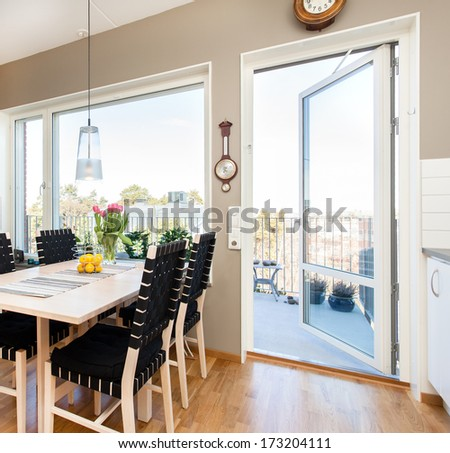 kitchen table by the open balcony door - stock photo
