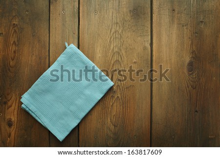 Kitchen table/Cookbook background. An old wooden kitchen table with kitchen dish cloth. - stock photo