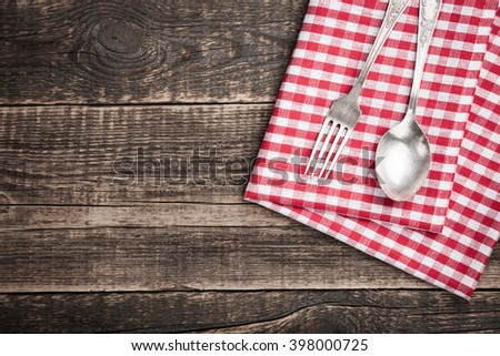 Kitchen table with napkin and cutlery - stock photo