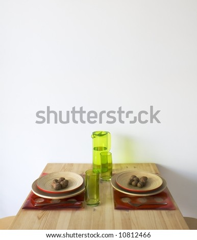 Kitchen table with walnuts in two wooden dishes