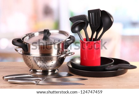 kitchen tools on table in kitchen - stock photo