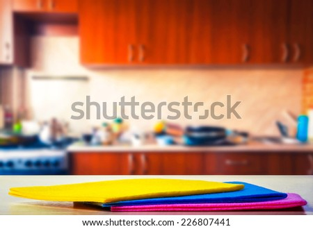 Kitchen towels on the kitchen table - stock photo
