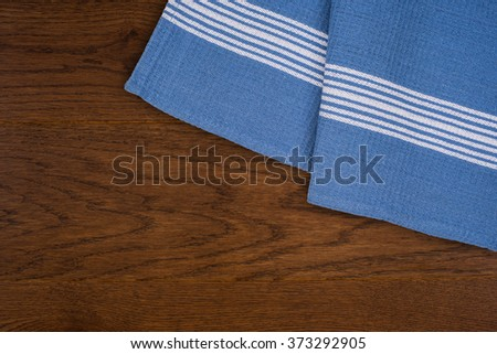 Kitchen towels on wooden background - stock photo