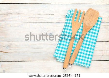 Kitchen utensil over white wooden table background. View from above with copy space - stock photo