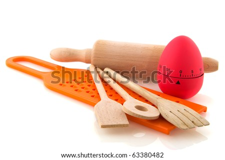 kitchen utensil with wooden spoons, cooking egg and grater - stock photo