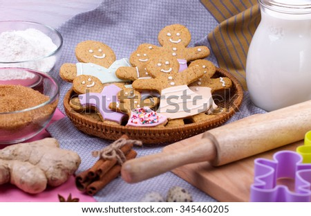 Kitchen utensils and ingredients for christmas homemade gingerbread cookies on wooden table. Anise, cinnamon, forms and decoration utensils. - stock photo