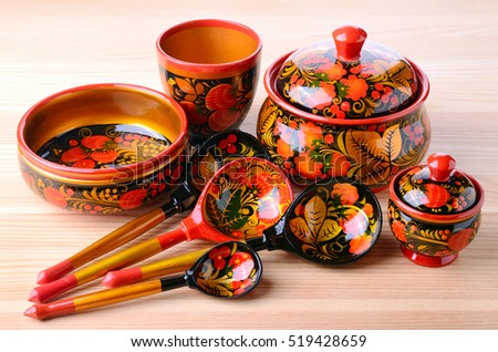 Kitchen utensils from Russian khokhloma. Traditional wood painting handicraft style and national ornament. First appeared in the second half of the 17th century in the Nizhny Novgorod.