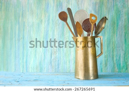 kitchen utensils in an old coffee pot, free copy space - stock photo