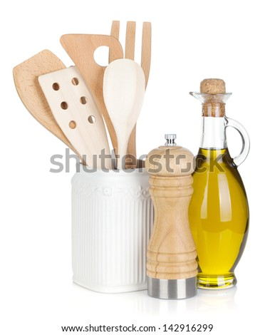 Kitchen utensils in holder and condiments. Isolated on white background - stock photo