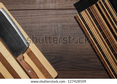 kitchen utensils on brown wooden table background - stock photo