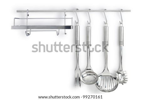 kitchen utensils on rack - stock photo
