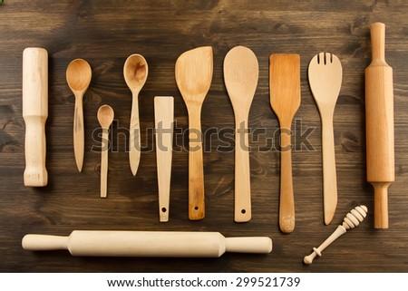 kitchen utensils on wooden background. spoon, mortar, kitchen spatula, rolling pin - stock photo