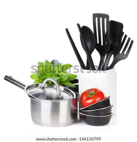 Kitchen utensils, tomato and mint leaves. Isolated on white background - stock photo