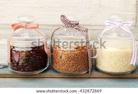 Kitchen ware in a rustic setting: glass tops with a natural organic cereals to cook a healthy food. Cute, romantic decor elements at home. Provence style