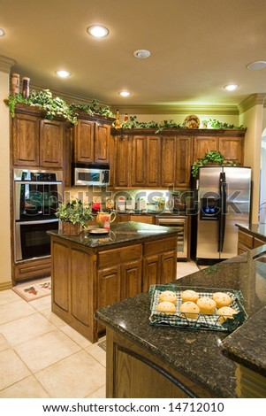 Kitchen with appliances and island - stock photo