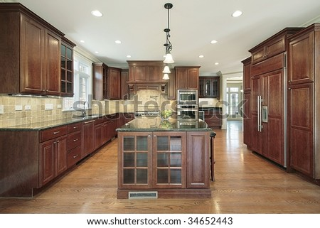 Kitchen with cherry oak cabinetry - stock photo