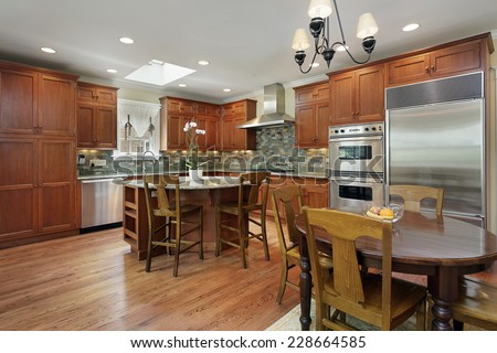 Kitchen with circular island and eating area - stock photo
