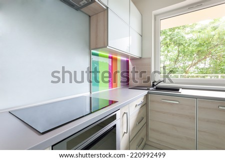 Kitchen with colorful decoration on the wall - stock photo