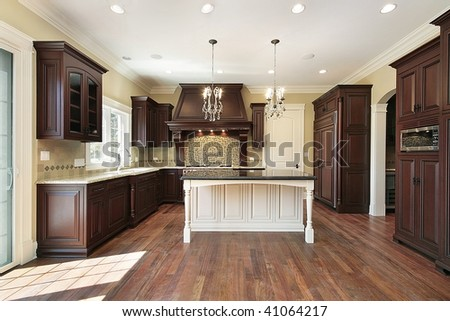 Kitchen with dark wood cabinetry - stock photo