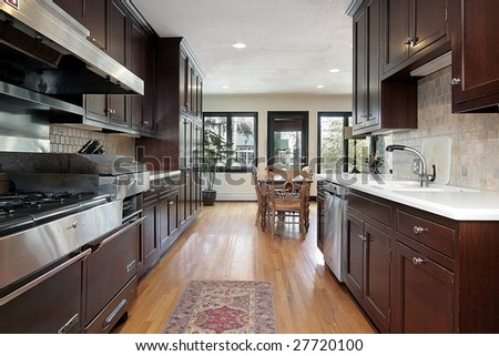 Kitchen with dark wood paneling