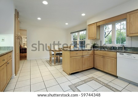 Kitchen with floor design and eating area - stock photo