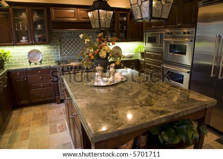 Kitchen with granite top island.