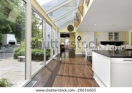 Kitchen with hallway and outside patio view - stock photo