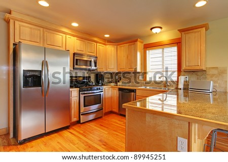 Kitchen with hardwood floor and granite. - stock photo