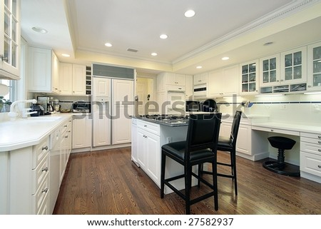 Kitchen with island and chairs