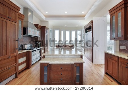 Kitchen with island and wood cabinets