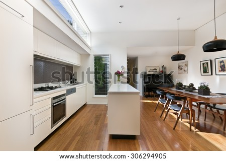 kitchen with modern twist along with hardwood floor, - stock photo