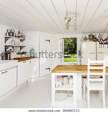 kitchen with open door out to the garden - stock photo