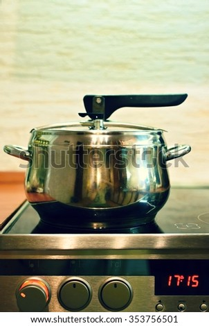 Kitchen with stove and pots. Pressure cooker.  - stock photo