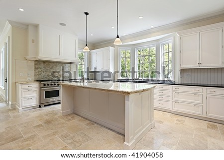 Kitchen with white cabinetry in new construction home - stock photo