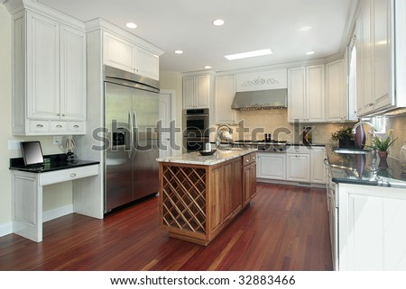 Kitchen with wood island in new construction home