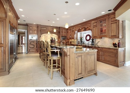 Kitchen with wood paneling and island