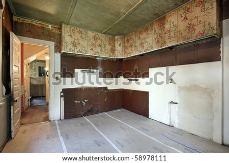 Kitchen without sink in old abandoned home - stock photo