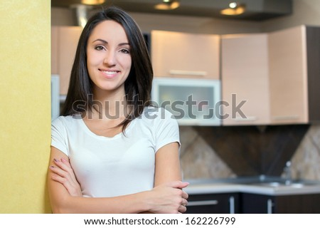 Kitchen Woman. Portrait of young beautiful woman. Kitchen background - stock photo