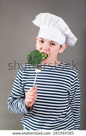 Kitchener eats broccoli - stock photo