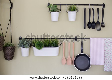 Kitchenware and tree  hanging on the wall. - stock photo