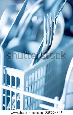 Kitchenware in dishwasher - stock photo